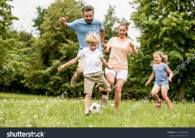 stock-photo-active-family-play-soccer-in-their-leisure-time-1013869084-min