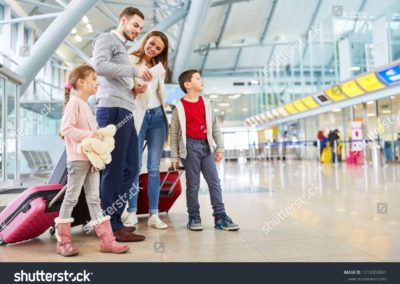 stock-photo-family-and-children-with-luggage-in-airport-terminal-fly-together-on-vacation-1210000891-min