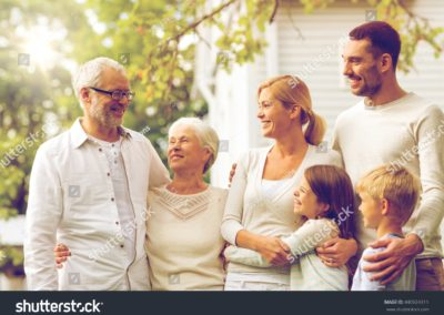 stock-photo-family-happiness-generation-home-and-people-concept-happy-family-standing-in-front-of-house-440924311-min