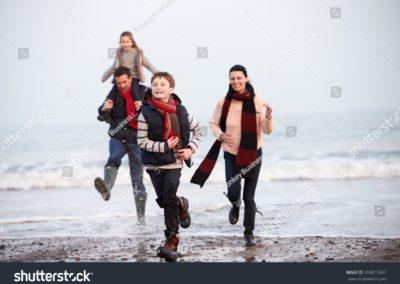 stock-photo-family-running-along-winter-beach-204813391-min