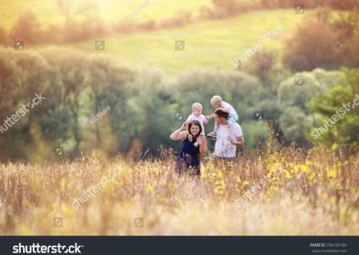 stock-photo-happy-family-enjoying-life-together-at-meadow-outdoor-236160184-min