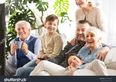 stock-photo-happy-family-watching-television-kids-sitting-next-to-parents-and-smiling-grandfather-1225186615