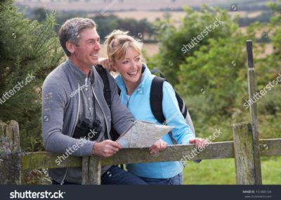 stock-photo-mature-couple-on-country-walk-151800104-min
