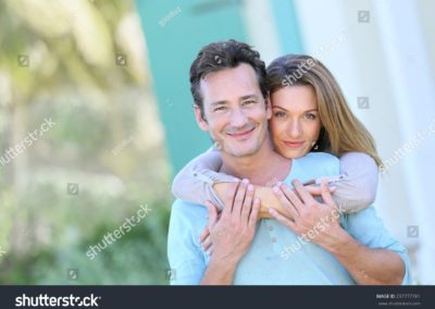 stock-photo-middle-aged-couple-embracing-in-front-of-house-237777781-min