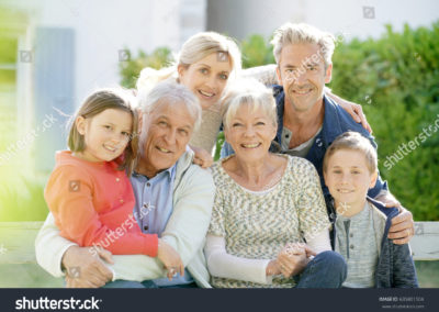 stock-photo-portrait-of-intergenerational-family-sitting-on-bench-635801504